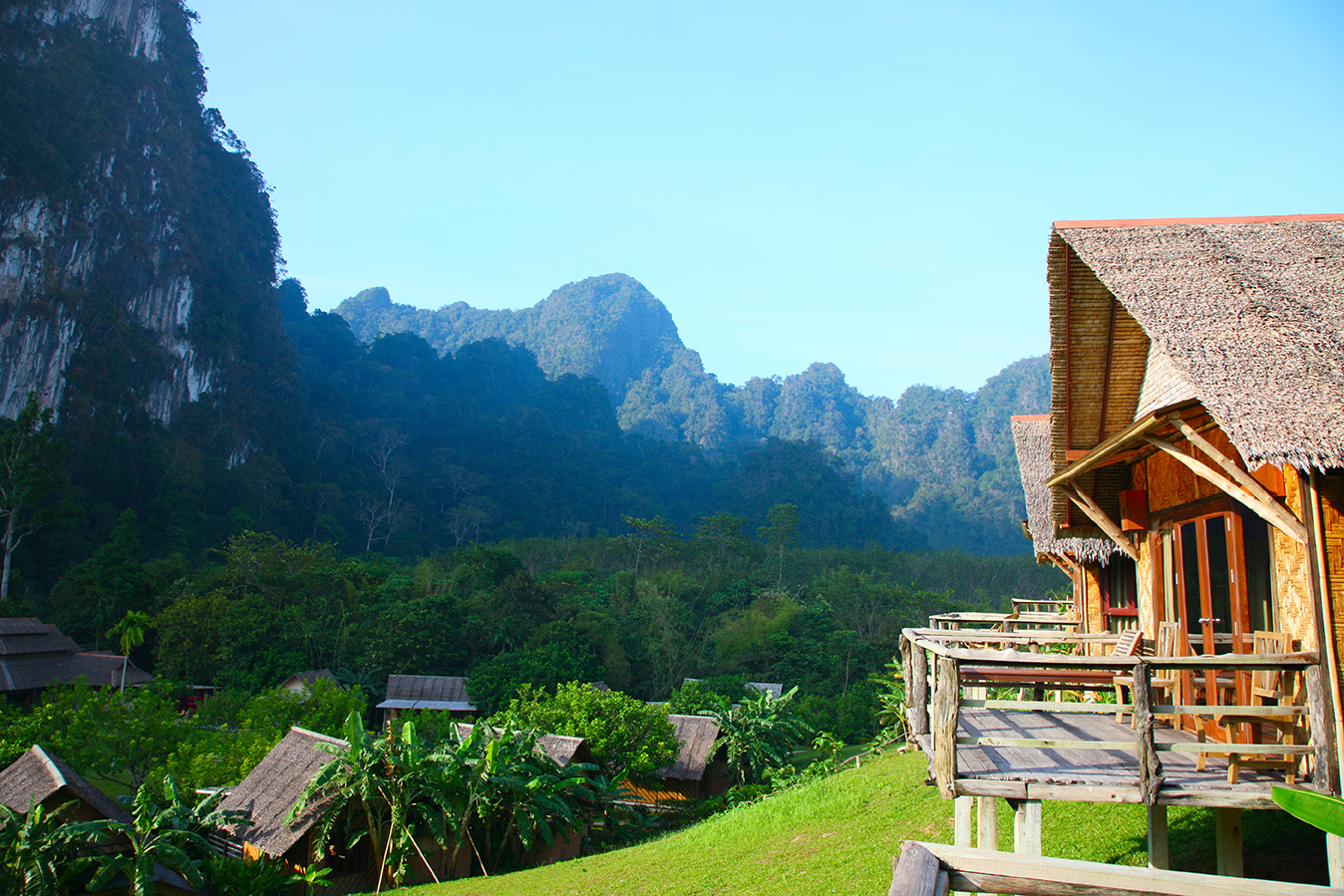 huts in beautiful green lush mountain ranges